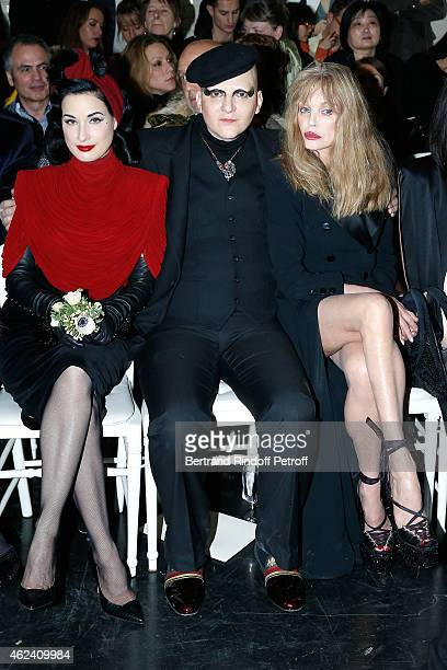 Dita Von Teese Ali Mahdavi and Arielle Domasle attend the Jean Paul Gaultier show as part of Paris Fashion Week Haute Couture Spring/Summer 2015 on...