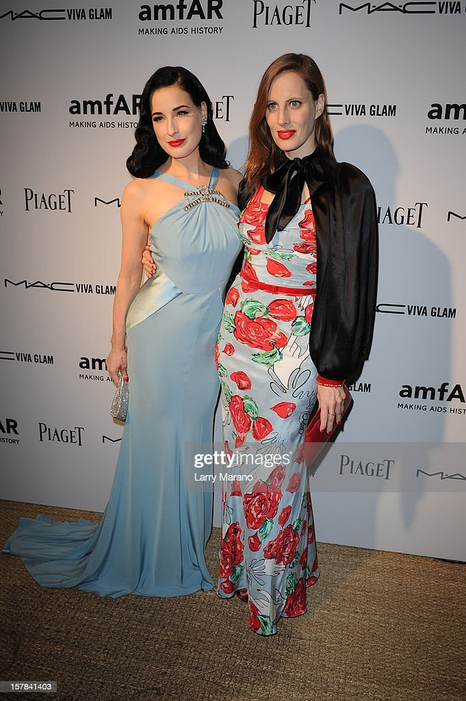 Dita Von Teese and actress/filmmaker Liz Goldwyn attend the amfAR Inspiration Miami Beach Party at Soho Beach House on December 6, 2012 in Miami Beach, Florida.