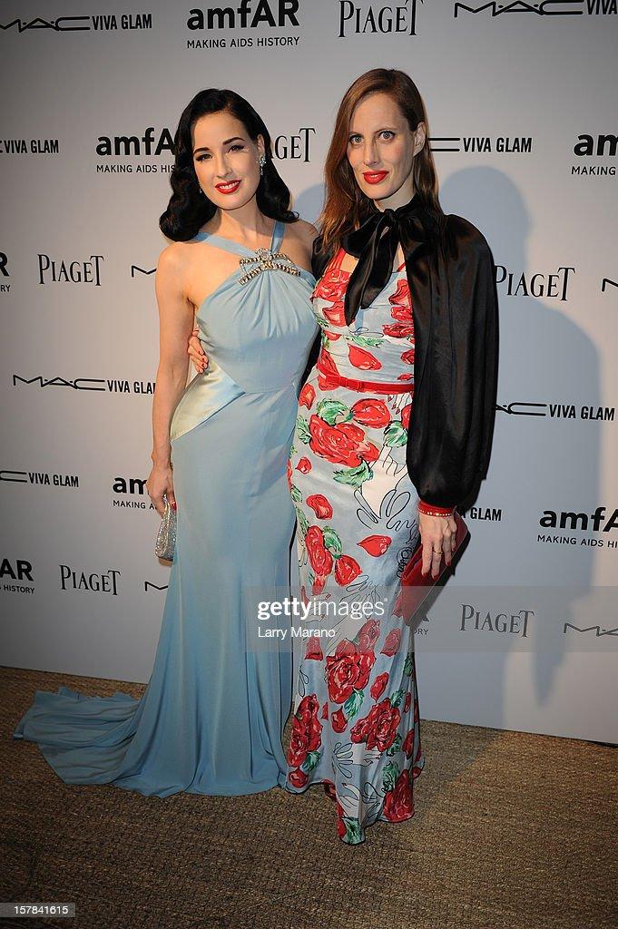 Dita Von Teese and actress/filmmaker Liz Goldwyn attend the amfAR Inspiration Miami Beach Party at Soho Beach House on December 6, 2012 in Miami Beach, Florida.