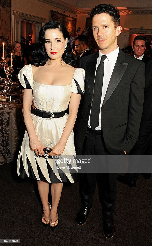 Dita Von Teese (L) and Andrew Armsrong attend a dinner celebrating the launch of 'Valentino: Master Of Couture', the new exhibition showing at Somerset House from November 29, 2012 to March 3, 2013, at the Italian Embassy on November 28, 2012 in London, England.