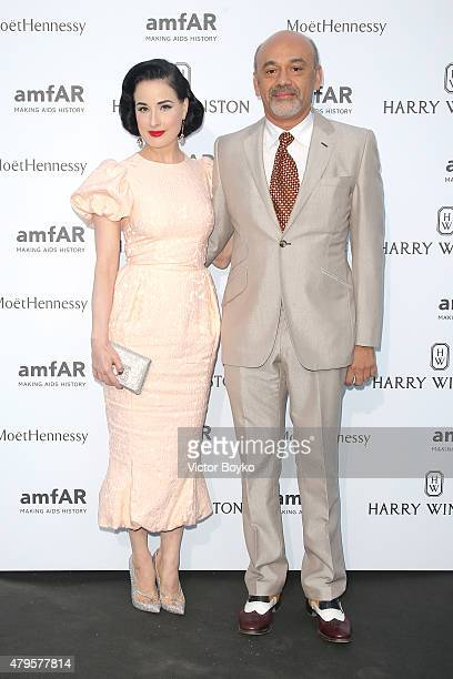 Dita Von Teese and Christian Louboutin attend the amfAR dinner at the Pavillon LeDoyen during the Paris Fashion Week Haute Couture on July 5 2015 in...