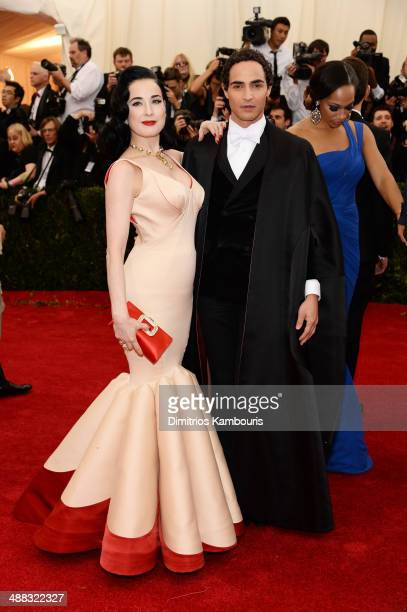 Dita Von Teese and designer Zac Posen attend the 'Charles James Beyond Fashion' Costume Institute Gala at the Metropolitan Museum of Art on May 5...