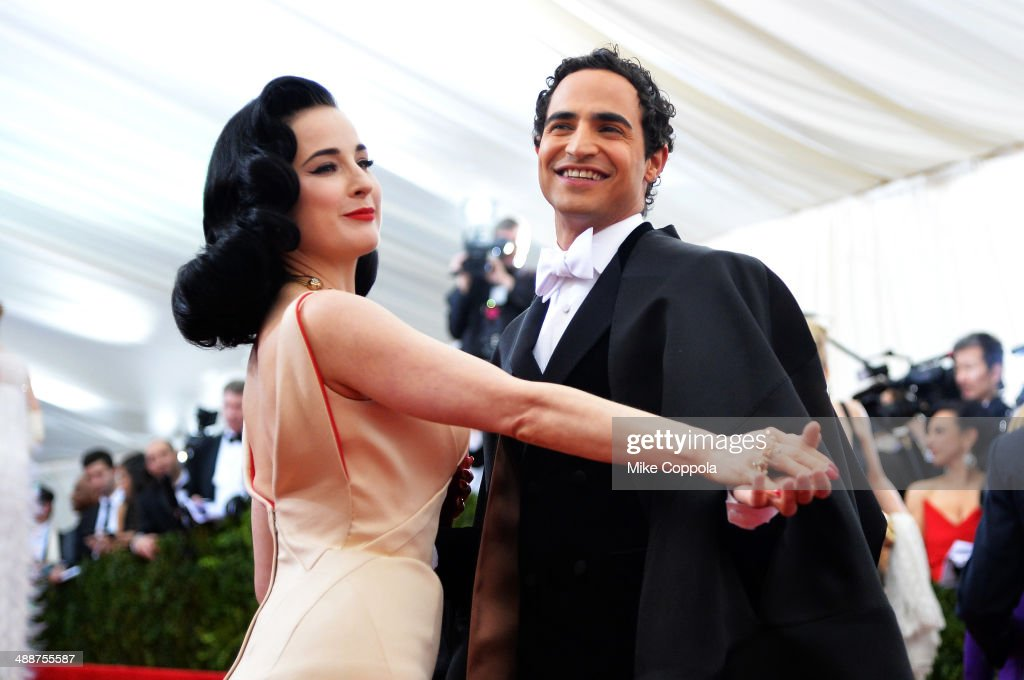 Dita Von Teese (L) and Designer Zac Posen attend the 'Charles James: Beyond Fashion' Costume Institute Gala at the Metropolitan Museum of Art on May 5, 2014 in New York City.