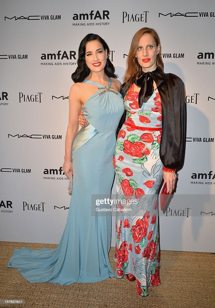 Dita Von Teese and <a gi-track='captionPersonalityLinkClicked' href=/galleries/search?phrase=Liz+Goldwyn&family=editorial&specificpeople=542651 ng-click='$event.stopPropagation()'>Liz Goldwyn</a> attend the amfAR Inspiration Miami Beach Party at Soho Beach House on December 6, 2012 in Miami Beach, Florida.