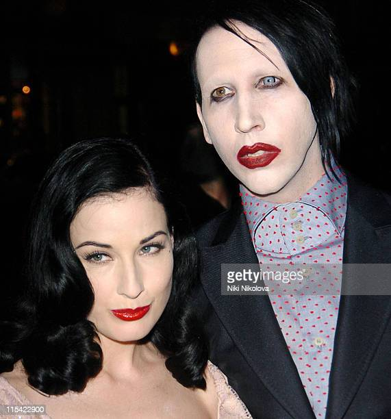 Dita Von Teese and Marilyn Manson during American and British Vogue London Fashion Week Cocktail Party February 17 2006 at Luciano in London Great...