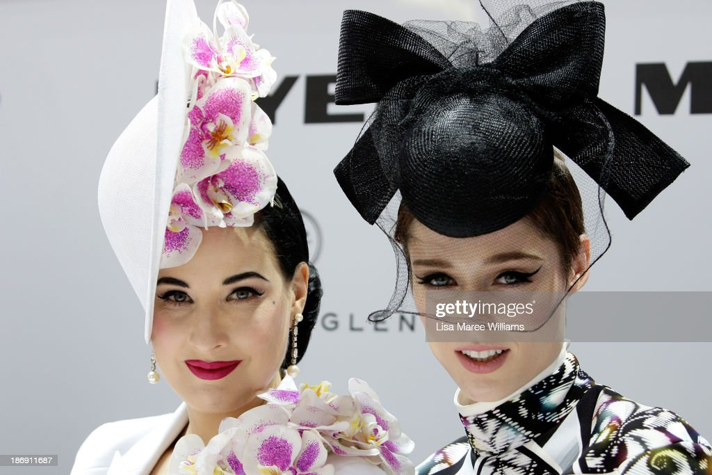 Dita von Teese (L) and model <a gi-track='captionPersonalityLinkClicked' href=/galleries/search?phrase=Coco+Rocha&family=editorial&specificpeople=4172514 ng-click='$event.stopPropagation()'>Coco Rocha</a> look on during judging of Myer Fashions on the Field during Melbourne Cup Day at Flemington Racecourse on November 5, 2013 in Melbourne, Australia.