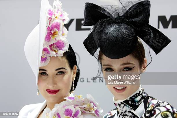 Dita von Teese and model Coco Rocha look on during judging of Myer Fashions on the Field during Melbourne Cup Day at Flemington Racecourse on...
