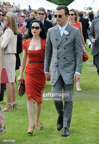 Dita Von Teese and Theo Hutchcraft attend The Cartier Queen's Cup Final at Guards Polo Club on June 17 2012 in Egham England