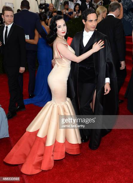 Dita Von Teese and Zac Posen attend the 'Charles James Beyond Fashion' Costume Institute Gala at the Metropolitan Museum of Art on May 5 2014 in New...