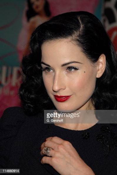 dita von teese signs her book 39 burlesque and the art of the teese 39 at