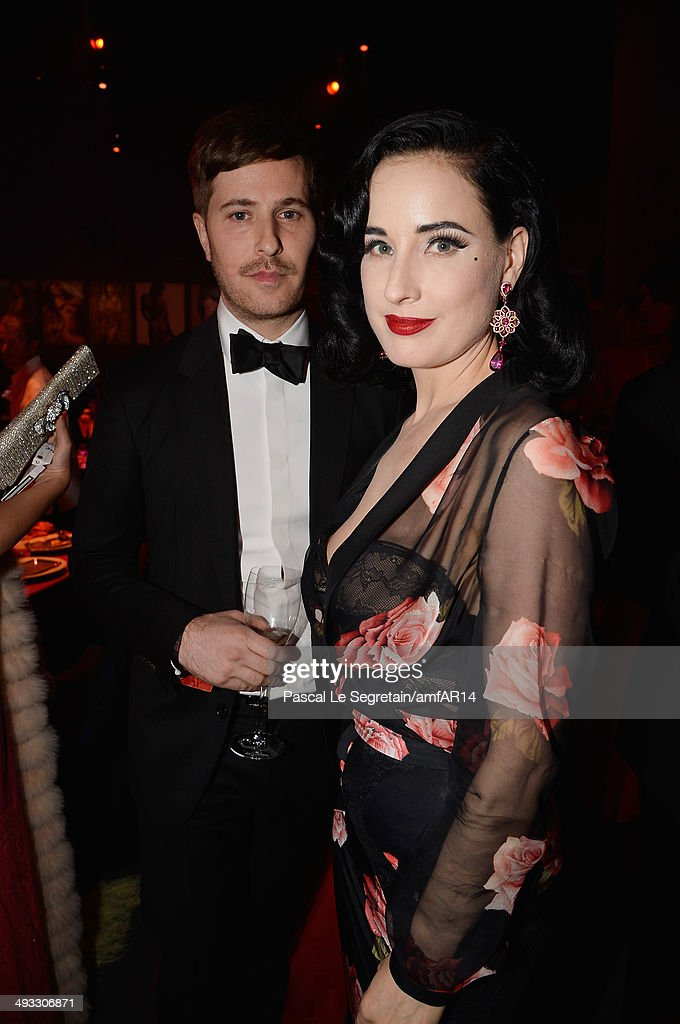 Dita von Teese (R) attends amfAR's 21st Cinema Against AIDS Gala Presented By WORLDVIEW, BOLD FILMS, And BVLGARI at Hotel du Cap-Eden-Roc on May 22, 2014 in Cap d'Antibes, France.