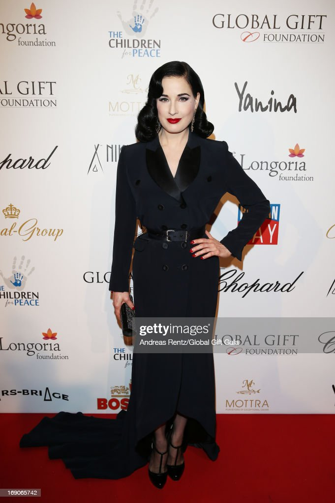 <a gi-track='captionPersonalityLinkClicked' href=/galleries/search?phrase=Dita+Von+Teese&family=editorial&specificpeople=210578 ng-click='$event.stopPropagation()'>Dita Von Teese</a> attends the 'Global Gift Gala' 2013 presented by Eva Longoria at Carlton Hotel on May 19, 2013 in Cannes, France.