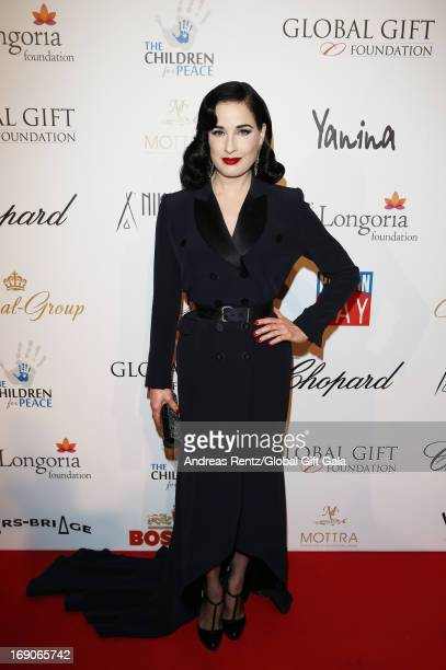 Dita Von Teese attends the 'Global Gift Gala' 2013 presented by Eva Longoria at Carlton Hotel on May 19 2013 in Cannes France