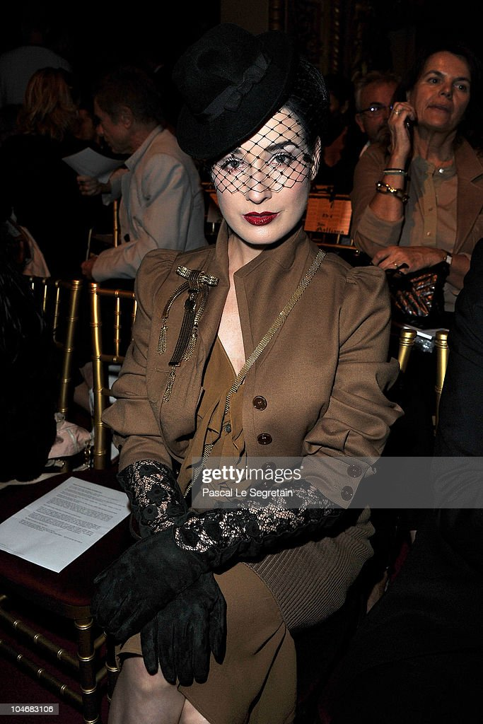 Dita Von Teese attends the John Galliano Ready to Wear Spring/Summer 2011 show during Paris Fashion Week at Opera Comique on October 3, 2010 in Paris, France.
