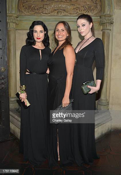 Dita Von Teese designer Rachel Pally and Michelle Trachtenberg attend the celebration for the Rachel Pally Fall 2013 Collection at Chateau Marmont on...