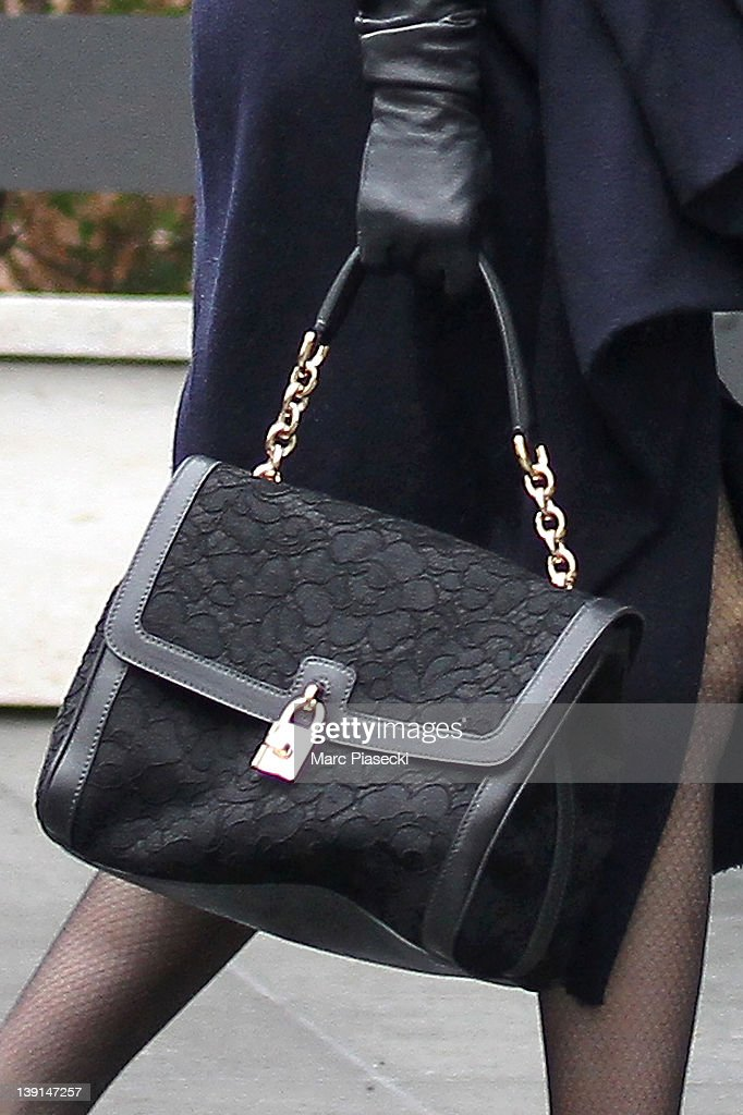 Dita von Teese (Dolce handbag detail) is sighted arriving at Firmenich France on February 17, 2012 in Paris, France.