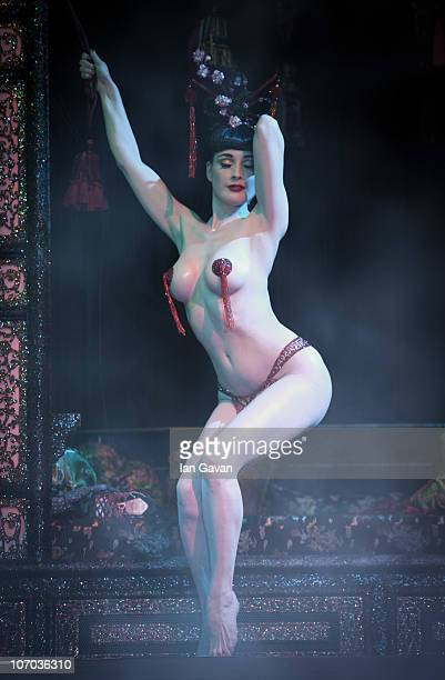 COVERAGE *** Dita Von Teese performs on stage during Erotica 2010 at Olympia Exhibition Centre on November 20 2010 in London England
