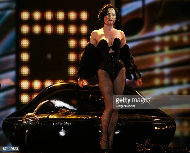 Dita Von Teese performs with singer Oscar Loya of Alex Swings Oscar Sings of Germany during the final of the Eurovision Song Contest on May 16 2009...