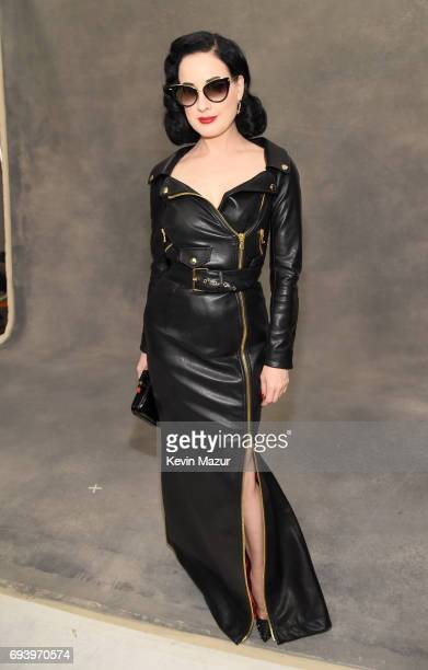 Dita Von Teese poses backstage at Moschino Spring/Summer 18 Menswear and Women's Resort Collection at Milk Studios on June 8 2017 in Hollywood...