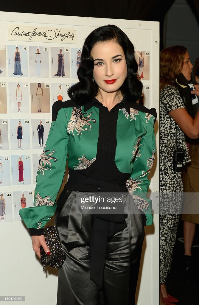 Dita Von Teese poses backstage at the Carolina Herrera fashion show during Mercedes-Benz Fashion Week Spring 2014 at The Theatre at Lincoln Center on September 9, 2013 in New York City.