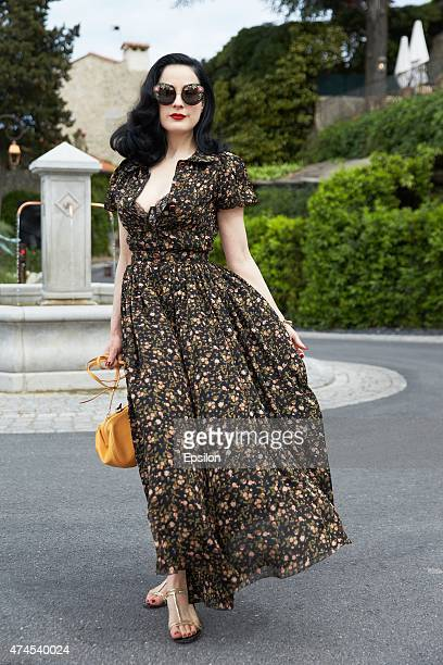 Dita Von Teese poses on the street during the 68th annual Cannes Film Festival on May 23 2015 in Mougins near Cannes France