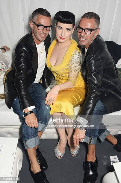 Dita Von Teese poses with Dean and Dan Caten attend Naomi Campbell's birthday party at the Billionaire Club Sunset Lounge on May 23 2014 in Monaco...