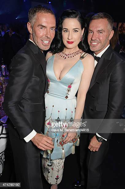 Dita Von Teese poses with Dean Caten and Dan Caten attend amfAR's 22nd Cinema Against AIDS Gala Presented By Bold Films And Harry Winston at Hotel du...