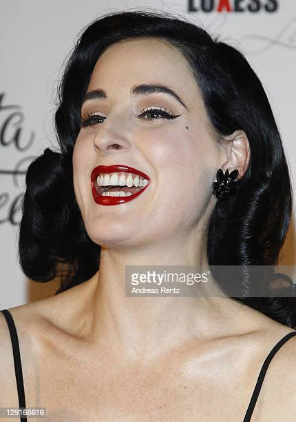 Dita Von Teese smiles during the launch of her own perfume line Eau de Dita at Soho house on October 13 2011 in Berlin Germany