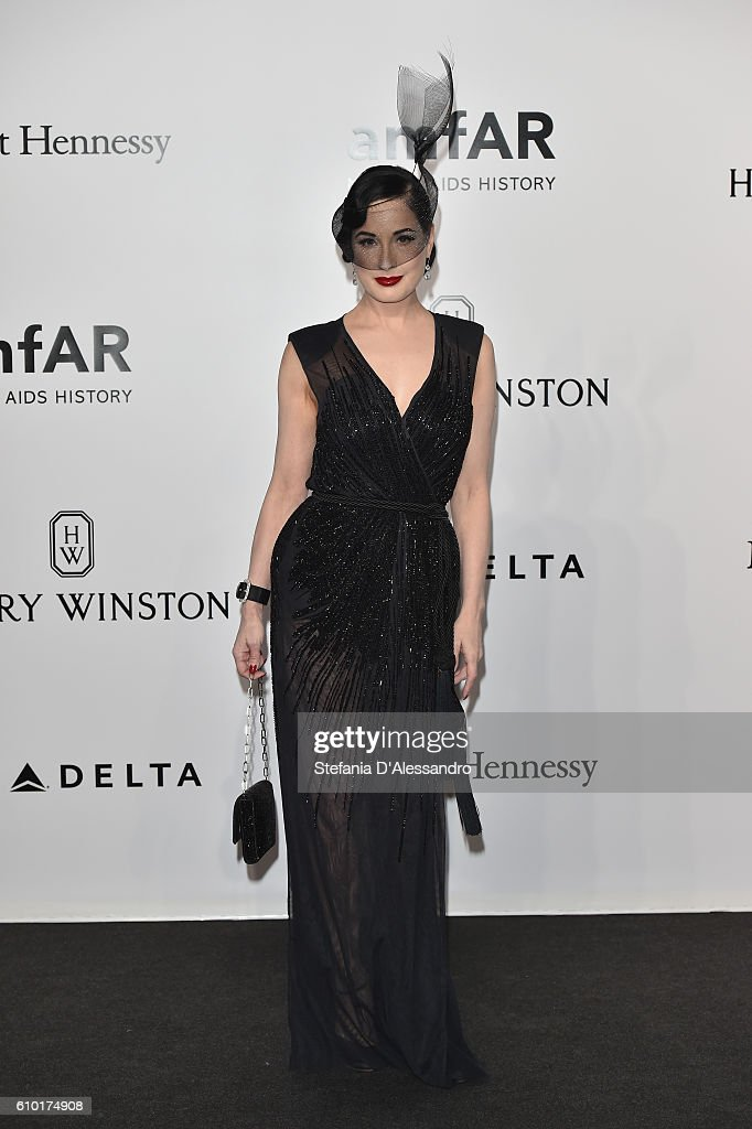 dita-von-teese-walks-the-red-carpet-of-amfar-milano-2016-at-la-on-picture-id610174908