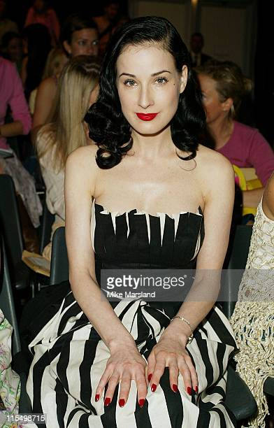 Dita von Teese watches the TataNaka fashion show during 2003 London Fashion Week TataNaka 2004 Spring Collection at Duke of York Kings Road in London...