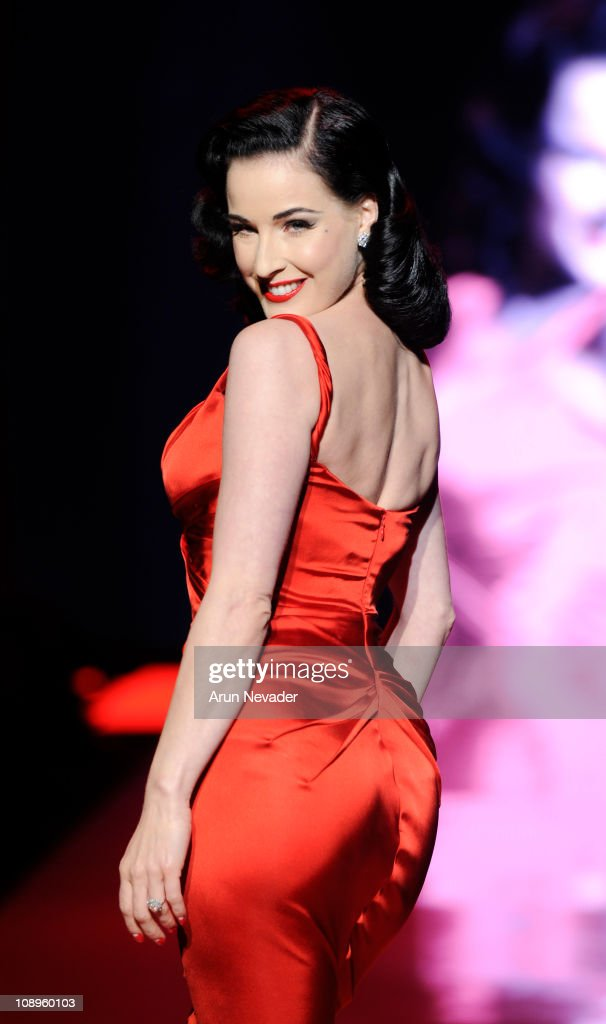 Dita Von Teese wearing Zac Posen walks the runway at the Heart Truth Fall 2011 fashion show during Mercedes-Benz Fashion Week at The Theatre at Lincoln Center on February 9, 2011 in New York City.
