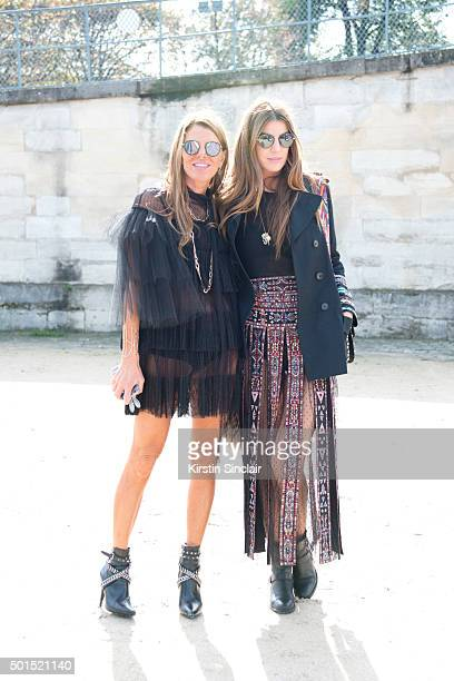 ditor At Large and Creative Consultant for Vogue Japan Anna Dello Russo wears Saint Laurent boots Valentino dress and bag and Spektre sunglasses with...