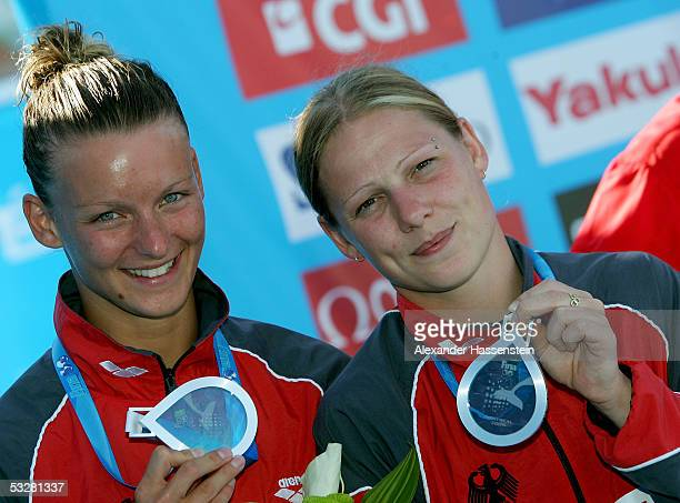 Ditte Kotzian and Conny Schmalfuss of Germany smile after winning the silver medal in the women's 3 meter Synchro Springboard final during the XI...