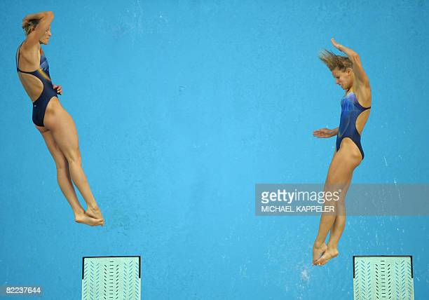 Ditte Kotzian and Keike Fischer of Germany compete in the women's synchronised 3m springboard diving competition final at the 2008 Beijing Olympic...