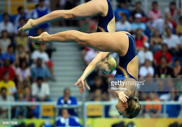 Ditte Kotzian left and Heike Fischer of Germany compete in the women's synchronized 3meter springboard diving event on day two of the 2008 Beijing...