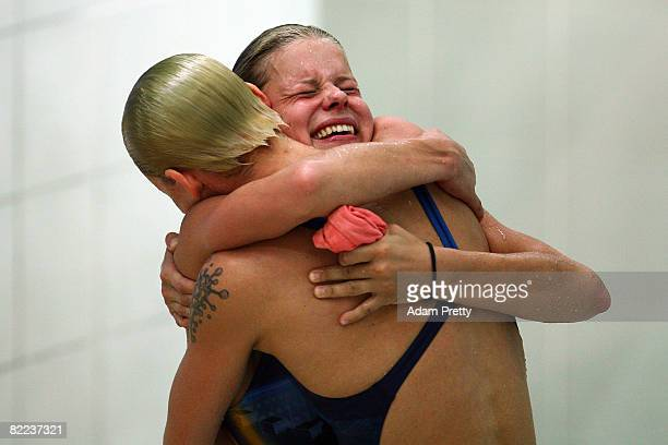Ditte Kotzian of Germany and Heike Fischer of Germany celebrate bronze in the Women's Synchronized 3m Springboard Final event held at the National...