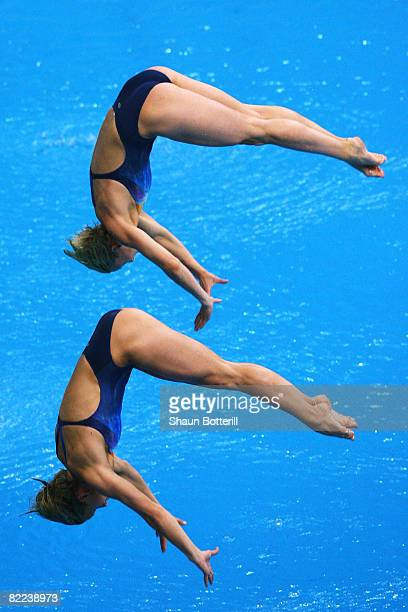 Ditte Kotzian of Germany and Heike Fischer of Germany competes in the Women's Synchronized 3m Springboard Final event held at the National Aquatics...