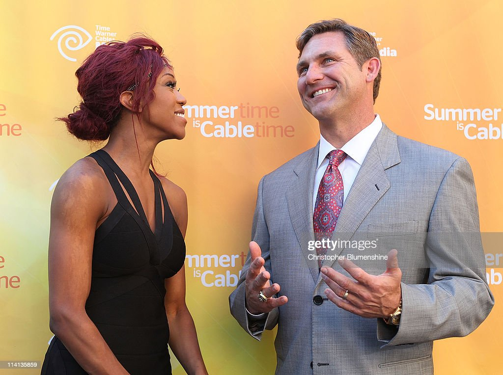 WWE Diva, Alicia Fox and college football analyst Craig James attend the Time Warner Cable Media Upfront Event 'Summertime Is Cable Time' on May 12, 2011 in Dallas, Texas.
