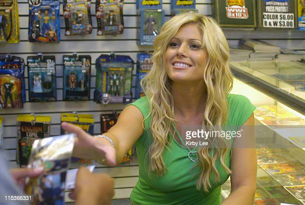 WWE Diva and Playboy Playmate Torrie Wilson signs autographs at RVD 5Star Comics at the Lakewood Center Mall in Lakewood Calif on Thursday August 19...