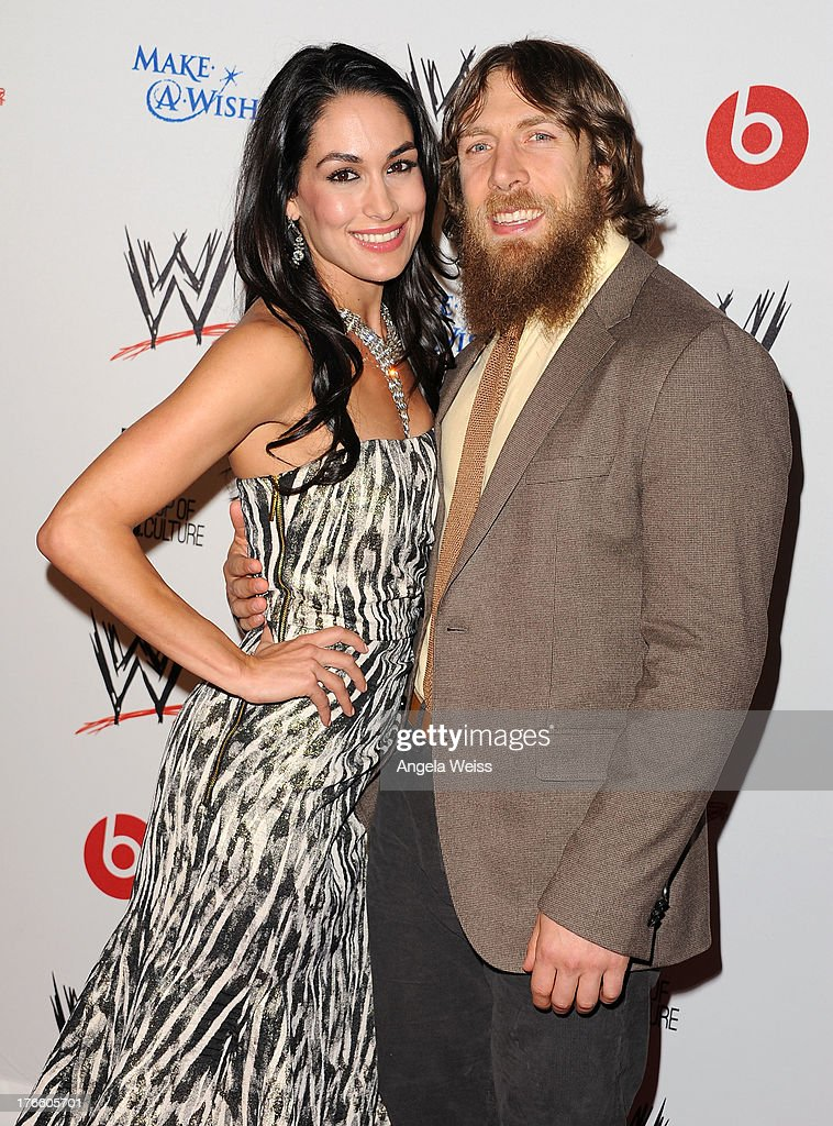 Diva Brie Bella (L) and wrestler Daniel Bryan arrive at WWE and E! Entertainment's 'Superstars For Hope' at Beverly Hills Hotel on August 15, 2013 in Beverly Hills, California.