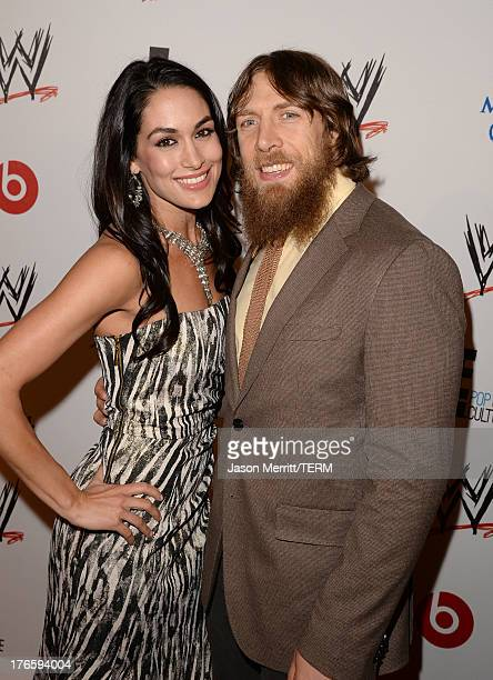 Diva Brie Bella and wrestler Daniel Bryan attend WWE E Entertainment's 'SuperStars For Hope' at the Beverly Hills Hotel on August 15 2013 in Beverly...