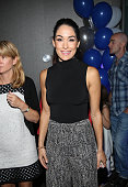 WWE diva Brie Bella attends the MakeAWish celebration event for John Cena's 500th Wish Granting Milestone at Dave Buster's Time Square on August 21...