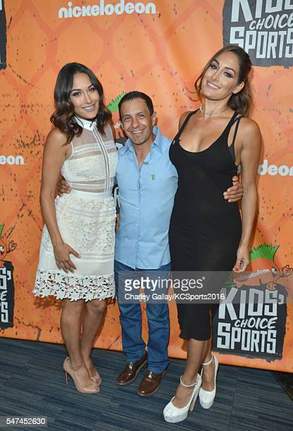 WWE Diva Brie Bella horse jockey Victor Espinoza and WWE Diva Nikki Bella pose in the green room during theNickelodeon Kids' Choice Sports Awards...