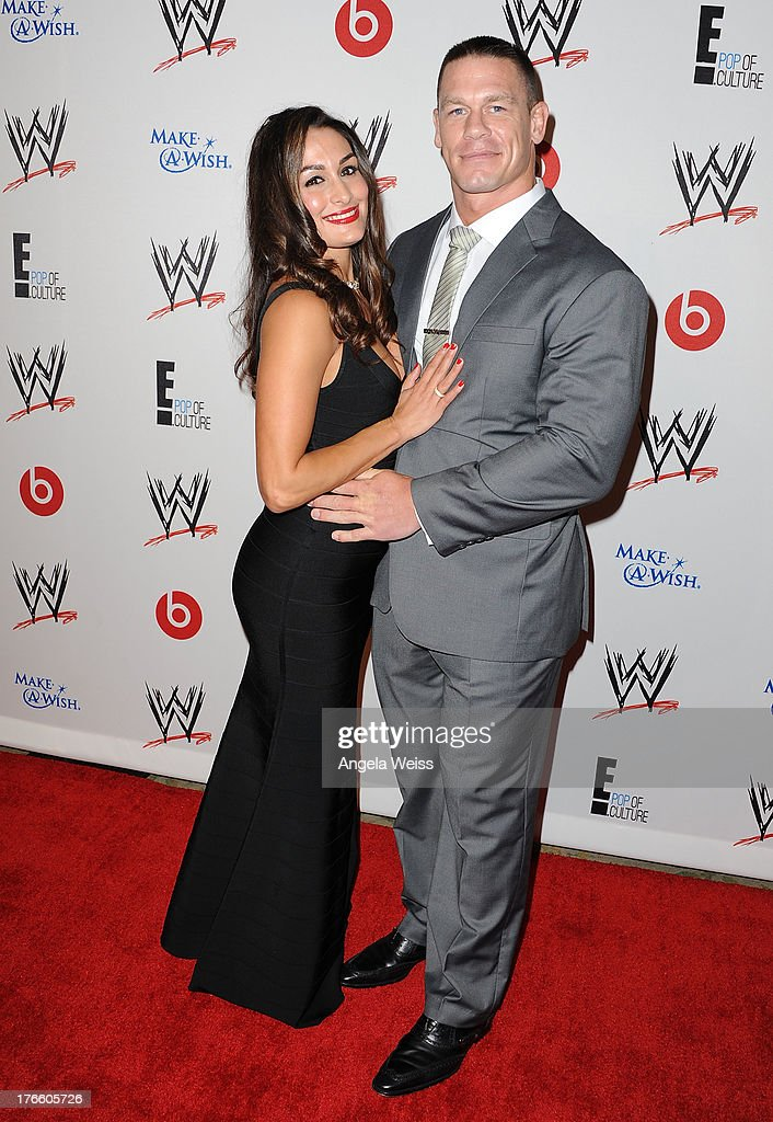 Diva Nikki Bella (L) and John Cena arrive at WWE and E! Entertainment's 'Superstars For Hope' at Beverly Hills Hotel on August 15, 2013 in Beverly Hills, California.