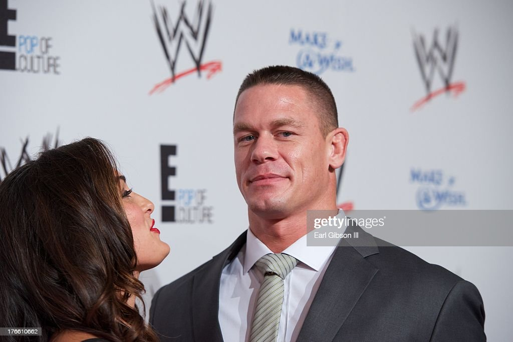 Diva Nikki Bella (L) and John Cena attend the WWE SummerSlam VIP Party at Beverly Hills Hotel on August 15, 2013 in Beverly Hills, California.