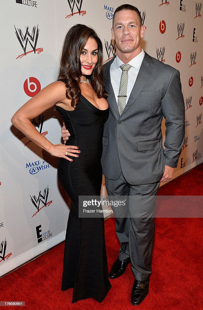 Diva Nikki Bella (L) and John Cena attend WWE & E! Entertainment's 'SuperStars For Hope' at the Beverly Hills Hotel on August 15, 2013 in Beverly Hills, California.