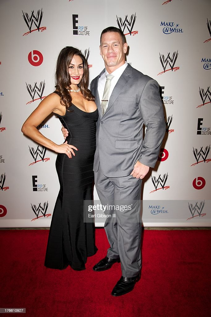 Diva Nikki Bella (L) and John Cena attends the WWE SummerSlam VIP Party at Beverly Hills Hotel on August 15, 2013 in Beverly Hills, California.