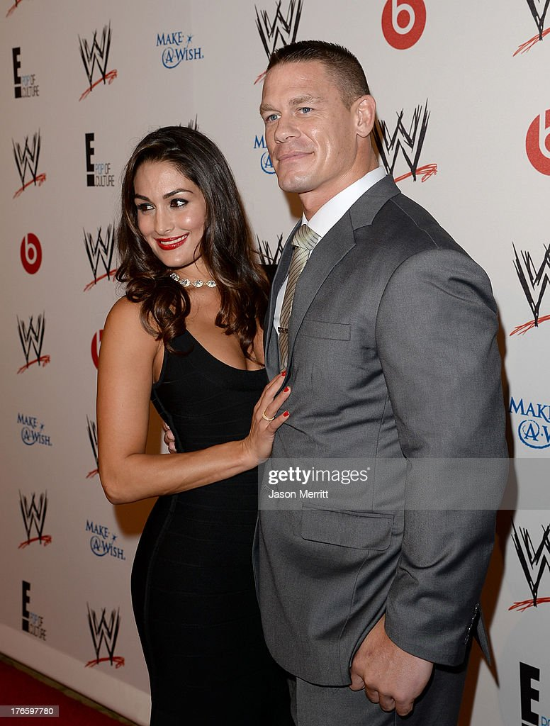 Diva Nikki Bella (L) and John Cena attends WWE & E! Entertainment's 'SuperStars For Hope' at the Beverly Hills Hotel on August 15, 2013 in Beverly Hills, California.