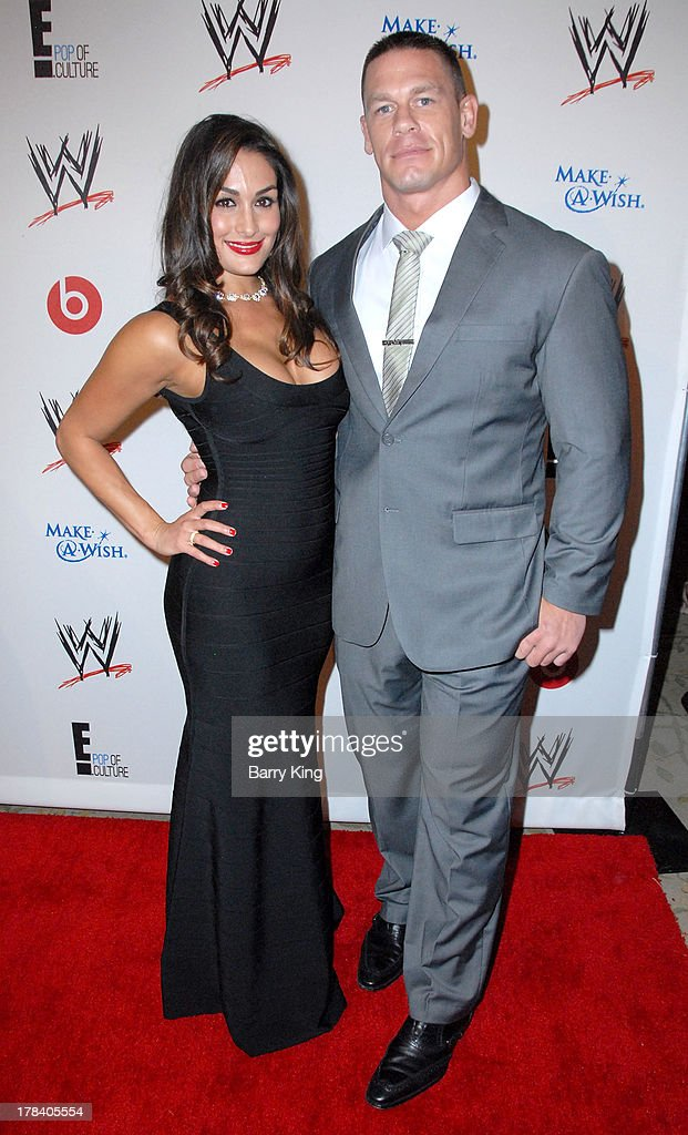Diva Nikki Bella (L) and WWE Professional Wrestler John Cena attend the WWE SummerSlam VIP party on August 15, 2013 at the Beverly Hills Hotel in Beverly Hills, California.
