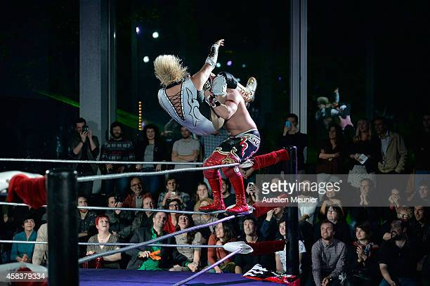 Diva Salvaje and Magnus perform onstage during the EXOTICOS VS LUCHADORES Lucha Libre Show hosted by La Fondation Cartier in Paris on November 3 2014...